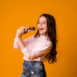 baby-girl-with-microphone-smiling-singing_98296-258