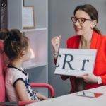 speech-therapist-teaches-girls-say-letter-r_153228-836