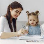 tutor-with-litthe-girl-studying-home_1157-33809