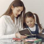 tutor-with-litthe-girl-studying-home_1157-34472