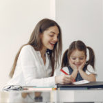 tutor-with-litthe-girl-studying-home_1157-34475